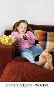 zapping TV, chips and cola