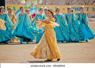 ZARAFSHAN, UZBEKISTAN - MARCH 21: Unidentified children dance and sing in celebration of the Navroz, spring Festival. March 21, 2012 in Zarafshan, Uzbekistan.