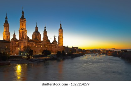 Zaragoza Cathedral / Basilica in Spain at sunset when the lights turn on.