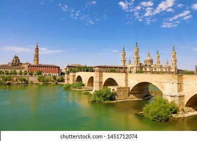 Zaragoza cityscape panorama with the bridge Puente de Piedra and Cathedral Basilica del Pilar