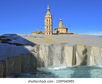 Zaragoza fountain closeup in daytime with the tower of the Cathedral of the Saviour behind (La Seo).