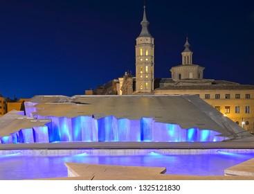 Zaragoza  fountain (Fuente de la Hispanidad) lit up at night in Plaza del Pilar, Spain.