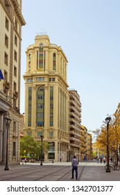 Zaragoza, Spain - April 22, 2018: Street with people and modern buildings