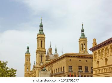 Zaragoza, Spain - April 22, 2018: Basilica of Our Lady of the Pillar  in Zaragoza, Spain with Francisco Goya  monument