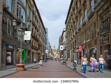 Zaragoza, Spain - April 24, 2018: Street leading to Pillar Plaza with many people
