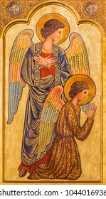 ZARAGOZA, SPAIN - MARCH 1, 2018:  The icon of prayered angels on the main altar in church Iglesia del Perpetuo Socorro by pater Jesus Faus (1953 - 1959).