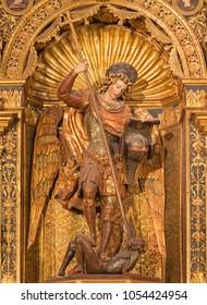 ZARAGOZA, SPAIN - MARCH 3, 2018: The polychome carved renaissance satatue of Michael archangel in church  Iglesia de San Miguel de los Navarros by Damian Forment (1519).