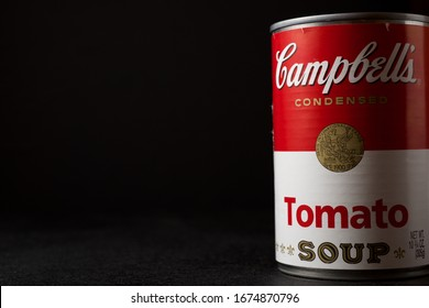 Zaragoza, Spain - March 4, 2020: Close-up of a can of Campbell's condensed soup on a black table.