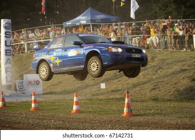 "ZARASAI, LITHUANIA - AUGUST 14: Arunas Vaiciunas drives a Slikas team Subaru Impreza car during ""300 Lakes Rally"", on August 14, 2010 in Zarasai, Lithuania"