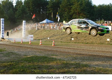 "ZARASAI, LITHUANIA - AUGUST 14: Martynas Samuitis drives an ARX Baltica Neiluva RT Mitsubishi Lancer EVO car during ""300 Lakes Rally"", on August 14, 2010 in Zarasai, Lithuania"