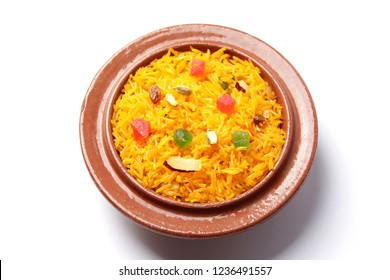 Zarda rice, Indian sweet rice dish in a clay bowl on white background.