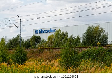 ZAROW/POLAND - AUGUST 16, 2018: View on Electrolux factory in special economic zone through the track