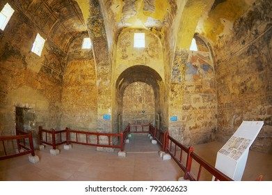 ZARQA, JORDAN - AUGUST 23, 2012: Interior of the ancient Umayyad desert castle of Qasr Amra with roman mural wall and ceiling decoration in Zarqa, Jordan.