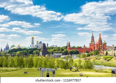 Zaryadye Park overlooking the Moscow Kremlin and St Basil's Cathedral, Russia. Zaryadye is the one of the main tourist attractions of Moscow. Panoramic scenic view of Moscow centre in summer.
