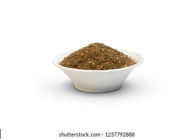 zatar in a white plate isolated on white .Za'atar. Satar. Middle Eastern herbs. Origanum syriacum. Thymus capitatus. Satureja thymbra .