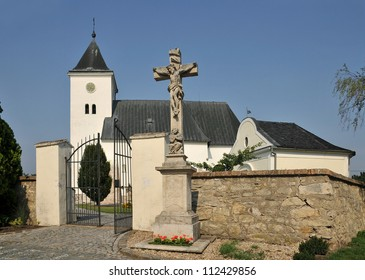 Zatcany at Brno, Czech Republic, stone cross at the Church of the Holy Trinity from the 11th century