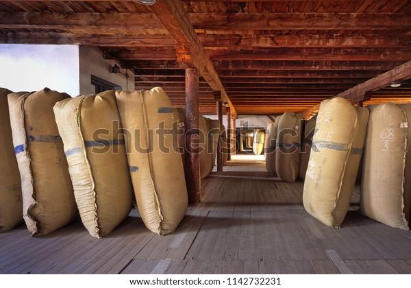 ZATEC TOWN,  CZECH REPUBLIC - August 25, 2017: Sacks of hops in historical storehouse in Zatec town.
