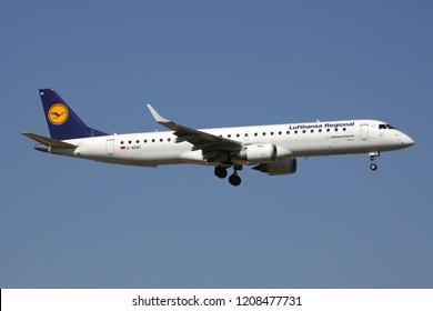 ZAVENTEM, BELGIUM - July 19, 2013: German Lufthansa CityLine Embraer ERJ-195 in old Lufthansa Regional livery with registration D-AEBC on short final for runway 01 of Brussels Airport.