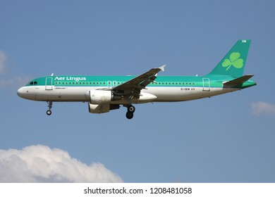ZAVENTEM, BELGIUM - July 19, 2013: Irish Aer Lingus A320-200 with registration EI-DEM on short final for runway 01 of Brussels Airport.