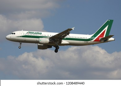 ZAVENTEM, BELGIUM - July 19, 2013: Italian Alitalia Airbus A320-200 with Irish registration EI-EID on short final for runway 01 of Brussels Airport.