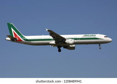 ZAVENTEM, BELGIUM - July 19, 2013: Italian Alitalia Airbus A321-100 with Irish registration EI-IXO on short final for runway 01 of Brussels Airport.