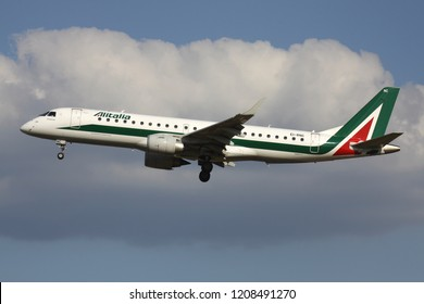 ZAVENTEM, BELGIUM - July 19, 2013: Italian Alitalia  Embraer ERJ-190 with Irish registration EI-RNC on short final for runway 01 of Brussels Airport.