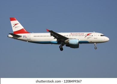 ZAVENTEM, BELGIUM - July 19, 2013: Austrian Airlines Airbus A320-200 with registration OE-LBS on short final for runway 01 of Brussels Airport.