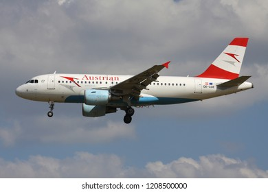 ZAVENTEM, BELGIUM - July 19, 2013: Austrian Airlines Airbus A319-100 with registration OE-LDE on short final for runway 01 of Brussels Airport.