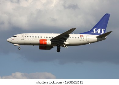 ZAVENTEM, BELGIUM - July 19, 2013: Scandinavian Airlines SAS Boeing 737-700 with registration LN-TUI on short final for runway 01 of Brussels Airport.