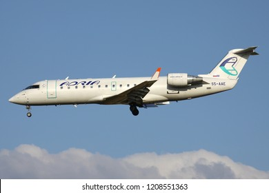 ZAVENTEM, BELGIUM - July 19, 2013: Slovenian Adria Airways Bombardier CRJ200 with registration S5-AAE on short final for runway 01 of Brussels Airport.