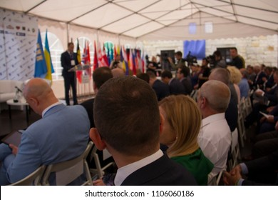 """Zbarazh, Ternopil region, Ukraine - 05.24.2018: Investment Forum """"Ternopil region Invest-2018"""" at Zbarazh castle: businessman who speaks to the audience on stage."""