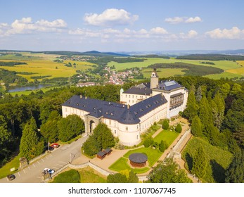 ZBIROH, CZECH REPUBLIC - JUNE 4, 2018: Aerial view of Chateau Zbiroh. Romanesque-Gothic castle was founded at the end of the 12th century. Famous tourist attraction in Czech republic, European union.