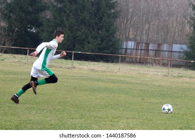 ZBYNOV, SLOVAKIA - MARCH 24,2019: Young soccer player of team FK Durcina runing with the ball in preseason friendly match against TJ Zbynov