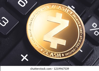 zcash cryptocurrency coin on the black calculator
