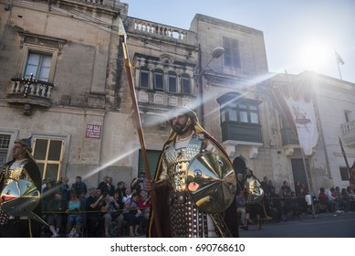 Zebbug, Malta - April 14,2017. Men dressed like Roman soldiers take part in a parade during the Good Friday Procession at the town of Zebbug in the southern Malta.