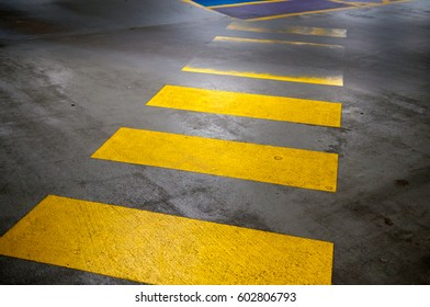 zebra crossing in yellow road markings