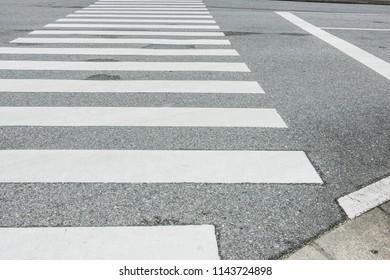 Zebra crosswalk on the road for safety people walking cross the street, Pedestrian crossing, asphalt road, White lines and crosswalk on street background