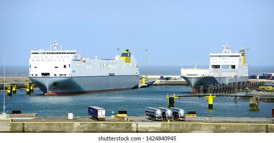 Zeebrugge, Belgium - 29th April 2019:CLDN RO-RO SA  Celine and Amandine Ro-Ro cargo Transporter ships taking on their cargos