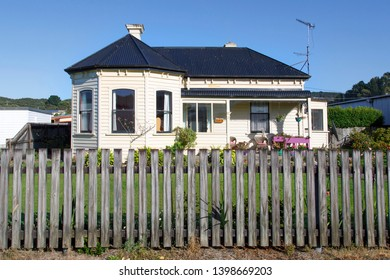 Zeehan, Tasmania: April 04, 2019: Traditionally built Tasmanian bungalow with corrugated roof, verandah and picket fence.
