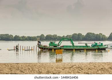 Zegerplas, Alphen aan den Rijn, South Holland, The Netherlands, July 11 2019: Construction scaffolding recreation area Zegersloot  open air swimming pool with sandy beach and cable ski run Wet'n Wild