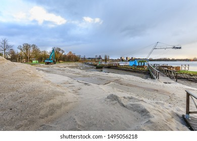 Zegerplas, Alphen aan den Rijn, South Holland, Netherlands, March 17 2019: Remediation of contaminated soil and restoration of water bottom, outdoor swimming pool and sandy beach