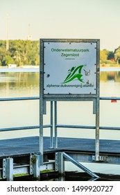 Zegerplas, Alphen aan den Rijn, Zuid Holland, Netherlands, July 30, 2019: Information board with announcement of the presence of an underwater nature park