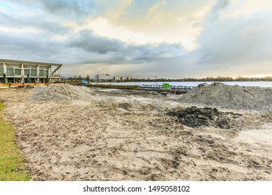 Zegerplas, Wet'n Wild, Alphen aan den Rijn, South Holland, Netherlands, March 19 2019: Remediation of contaminated soil and restoration of water bottom, outdoor swimming pool and sandy beach