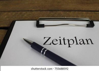 Zeitplan (german for schedule) on a wooden box close up