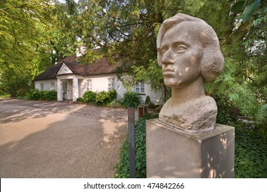 ZELAZOWA WOLA, POLAND - AUGUST 20: Statue of Frederick Chopin in the park against his birthplace - little manor-house on August 20, 2016 in Zelazowa Wola, Poland. Selective focus on the bust