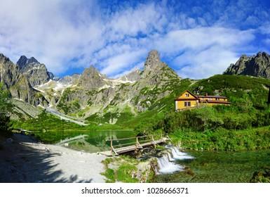 Zelene pleso lake in Tatra mountains with beautiful  bridge over waterfall - idyllic summer, Slovakia