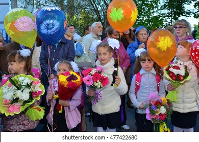 Zelenograd, Russia - September 1, 2016: primary school children with teachers and parents on the first day of the school year. Feast Day of Knowledge.