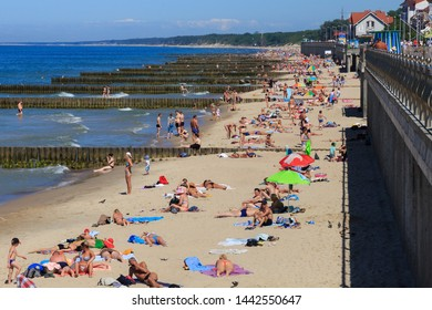 ZELENOGRADSK, KALININGRAD REGION, RUSSIA - JUNE 18, 2019: Unknown people resting on a sandy beach on the Baltic Sea coast in famous resort Zelenogradsk (formerly known as Cranz) at summer time.