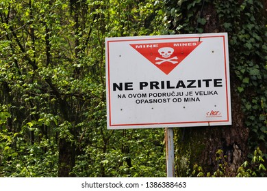 ZELJAVA, CROATIA - APRIL 14 2019: Watch out for mines sign, minefield close to the border of Croatia and Bosnia.
