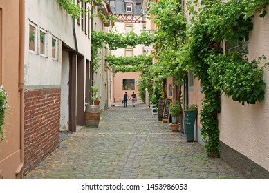 Zell, Germany - June 6th, 2019: Vine tendrils crossing the streets in village Traben-Trarbach along the river Moselle in Germany